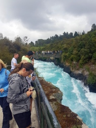 Caitlyn getting her phone ready to take a video at the Huka Falls